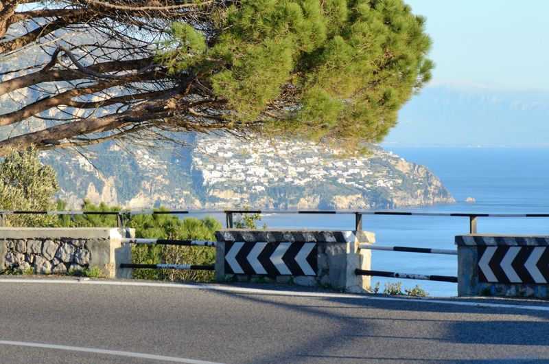 Costiera Amalfitana: Amalfi Coast Road -Italy Italy Italia Travel Destinations Travel Traveling Amazing View Amalfi Coast Amalfi  Minori Vacations Costiera Amalfitana Road Roads Driving Drive Tree Water Sea Beach Clear Sky Sky Horizon Over Water Architecture Calm Tranquil Scene Sandy Beach Tranquility Shore Scenics Idyllic