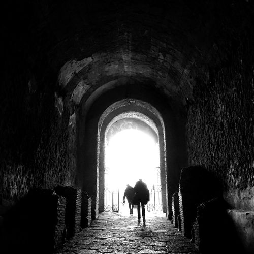 To the new world Architecture Tunnel Walking Men Italy Blackandwhite Black & White Blackandwhite Photography EyeEmNewHere Backlight Shadow
