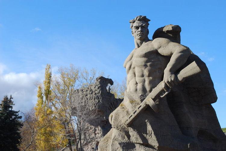 Low angle view of sculptures at mamayev kurgan park against sky