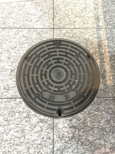 雨水 Rain Water Iron OSAKA マンホール Utility Hole Lid Circle Geometric Shape Shape Pattern Day High Angle View No People Design Manhole  Metal Outdoors