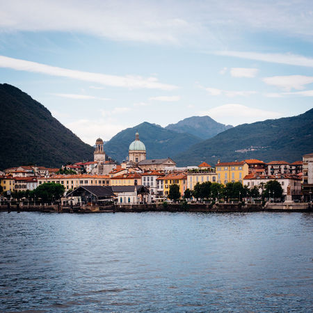 TOWNSCAPE Laggo Maggiore Architecture Built Structure Mountain Building Exterior Water Building Waterfront Sky Cloud - Sky City Mountain Range No People Nature Residential District Religion Day Beauty In Nature Scenics - Nature Place Of Worship Outdoors Cityscape Lakeside Scenics Idyllic Town Old Town Bell Tower - Tower Housing Settlement