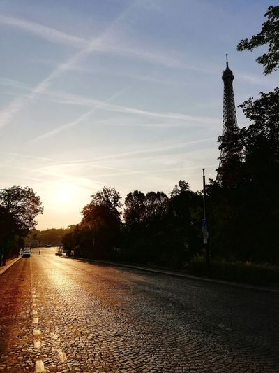PARIS, FRANCE - AUGUST 19, 2018 : Empty street in Paris on beautiful sunrise morning with Eiffel tower on background City Cityscape Eiffel Tower Urban Sunrise Sunset Morning Light Landscape Architecture Street Summertime Beautiful Morning Light Travel Destinations Landmark Famous Place Nobody Travel Photography Tourist Destination Trees Tree Sunset Road Sky Cloud - Sky Empty Road Tranquil Scene Calm Tranquility Scenics