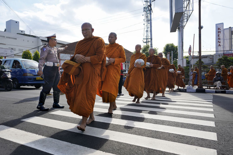 Bhikkhu Buddhist Monks Crossing Crosswalk Group Of People Men Real People Street Street Photography Streetphotography Walking Zebra Crossing The Photojournalist - 2018 EyeEm Awards The Street Photographer - 2018 EyeEm Awards