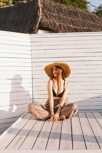 Portrait of woman sitting on wood