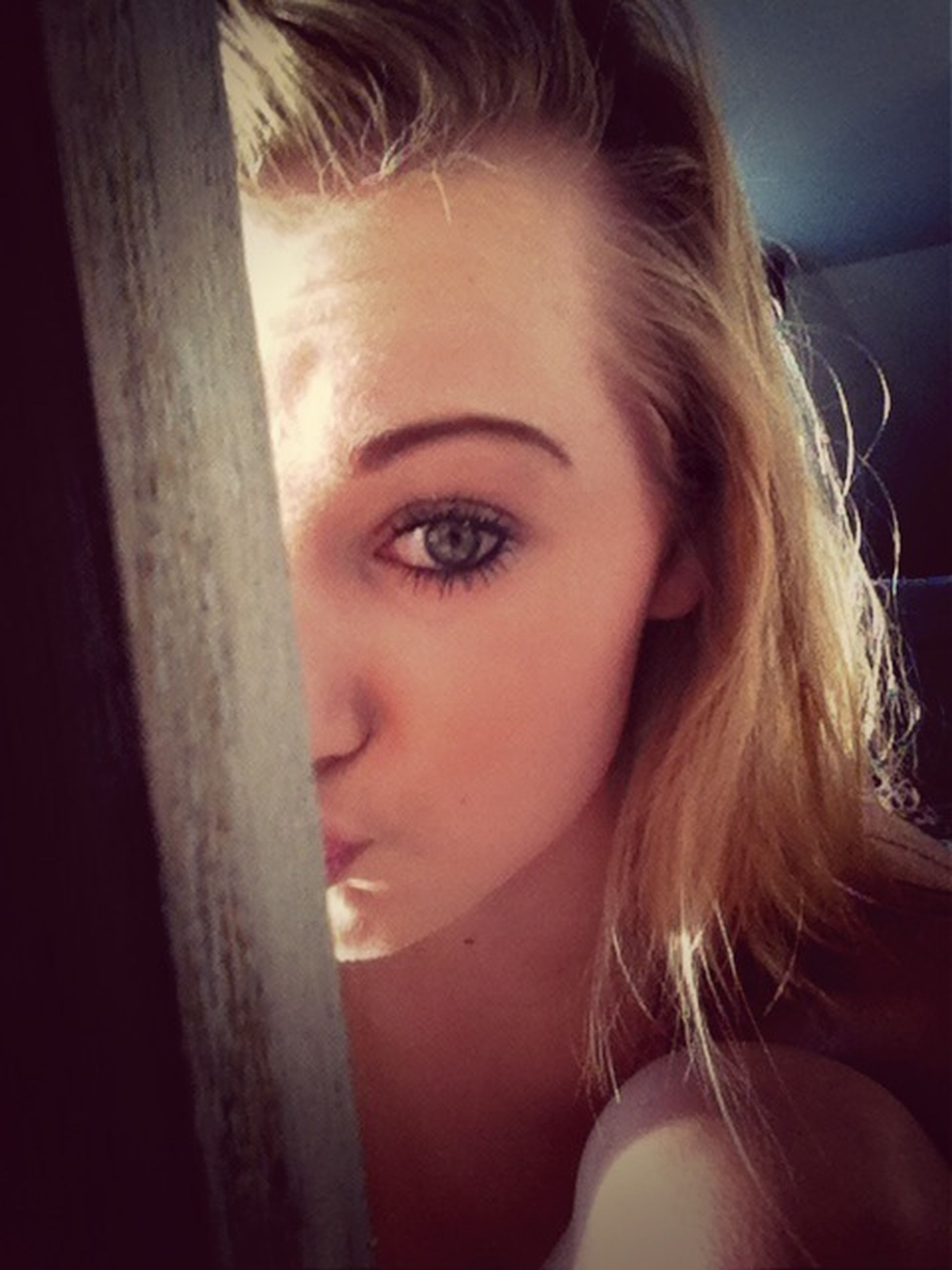 headshot, person, indoors, young women, close-up, lifestyles, portrait, head and shoulders, looking at camera, long hair, leisure activity, young adult, human face, blond hair, contemplation, front view