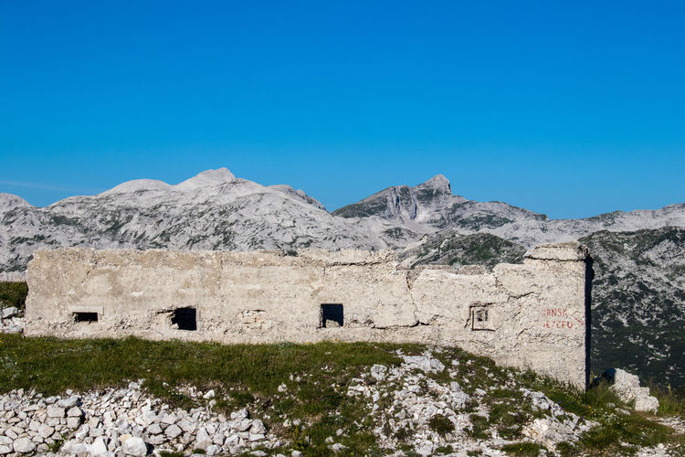 look over barrack from 1 world war to mountains Slovenia Architecture Barracks Blue Building Building Exterior Built Structure Clear Sky Day Garisson History Julian Alps Military Mountain Nature No People Outdoors Scenics - Nature Sky Sunlight World War 1