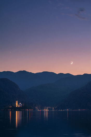 City Silhouette Astronomy Beauty In Nature Clear Sky Dawn Idyllic Lake Lake View Landscape Light And Shadow Moon Mountain Mountain Range Nature No People Outdoors Scenics Sky Sun Sunset Tranquil Scene Tranquility Water