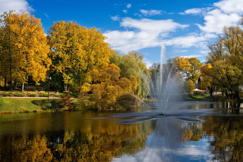 Valmiera. Latvia. City autumn landscape with a pond and fountain. Autumn Autumn colors Baltic Baltic Countries Fountain Latvia Valmiera Autumn Collection Baltic States Beauty In Nature Cloud - Sky Day Flowing Water Foliage Lake Motion Nature No People Outdoors Reflection River Scenics - Nature Sky Tree Water