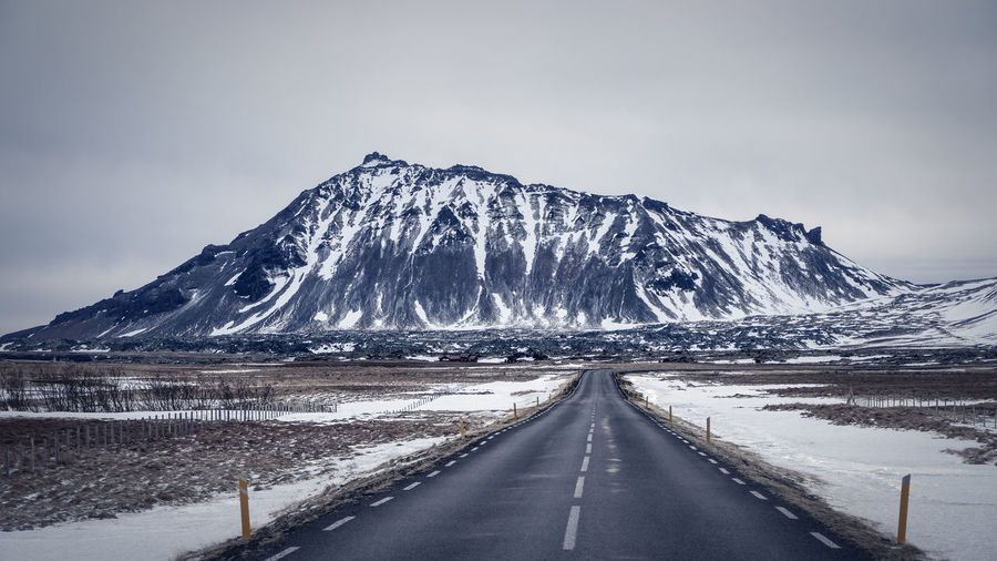 Asphalt Iceland Road Winter Wintertime Beauty In Nature Cold Temperature Diminishing Perspective Direction Divider Dividing Line Grey Landscape Mountain Nature No People Non-urban Scene Road Road Trip Scenics - Nature Sky Snow The Way Forward Tranquil Scene Winter
