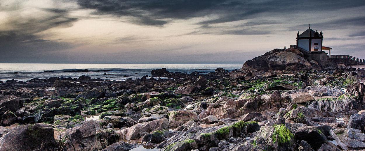 Capela Senhor da Pedra Beach City Cloud - Sky Day Horizon Over Water Landscape Nature No People Outdoors Postcard Rock - Object Scenics Sea Sky Sunset
