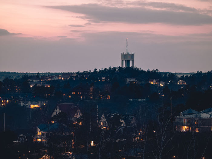 High angle view of city lit up at dusk