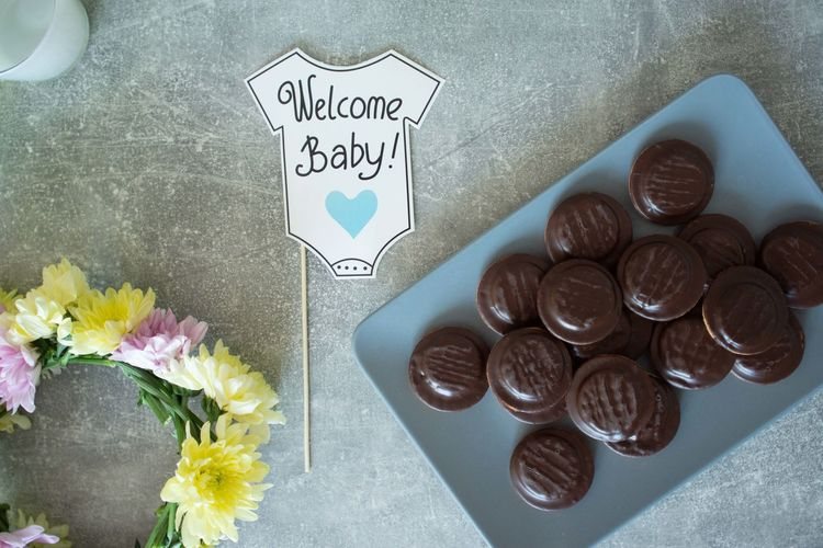 Baby Arrangement Baby Shower Close-up Coffee - Drink Communication Flower Food Freshness High Angle View Indoors  No People Snack Table Western Script