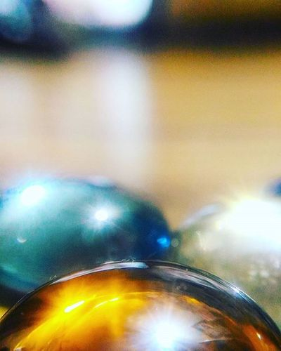 Glass Pebble Wood Wooden Table Surface Colorful Colours Cyan Orange White Reflection Polished Lowlights PhonePhotography Photography Asus Zenfone2 ZenfoneSelfie Phonecamera Shine SuperMacro Macroshot Wideshot CarlZeiss cropped lights