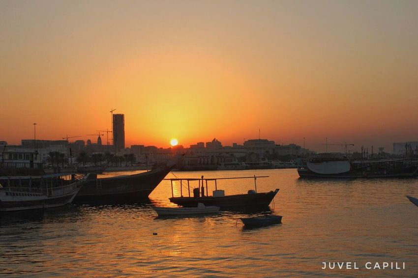 Sunset Architecture Water Transportation Nautical Vessel Building Exterior Orange Color City Sea Mode Of Transport Reflection Waterfront No People Skyscraper Outdoors Sky Nature Cityscape Beauty In Nature