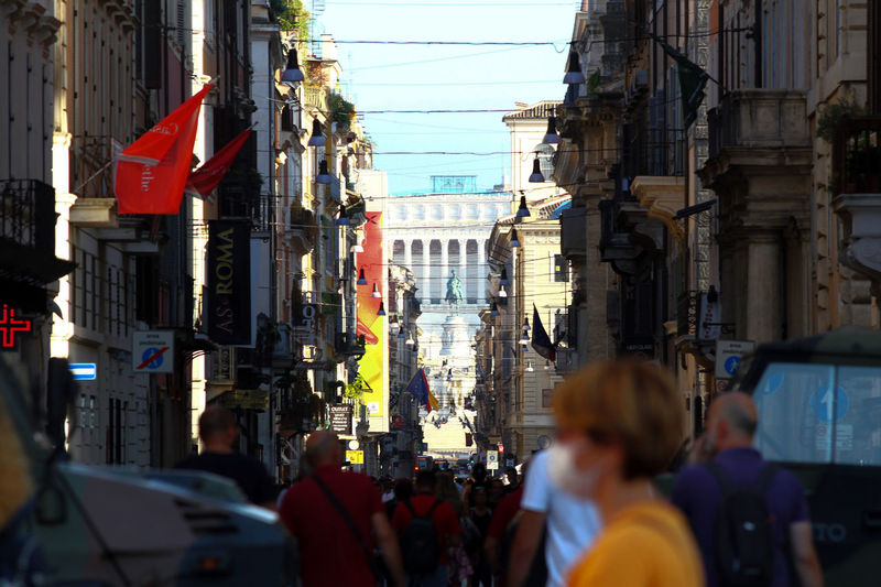 Via del corso, rome. crowded street, in the foreground, piazza venezia in the background.