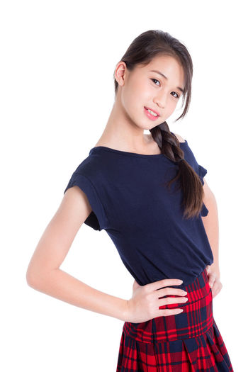 Isolated Female Teen White Woman Young Girl Portrait Happy Smile Teenager Attractive person Beautiful Student Asian  Casual Pretty Lady Smiling Background Joyful Confident  People Beauty Cute Natural Studio Lifestyle Cheerful School Modern One Model Youth Joy Education Thai Skirt