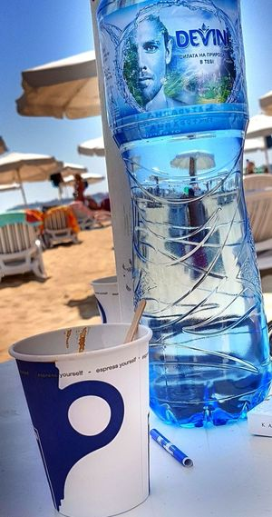 Good morning Beach Life Beach Photography Coffee Sunny Vacation Time At The Sea Beach Beachphotography Close-up Day Freshness No People Outdoors Sand Sky Summer Vacation Water Water Bottle