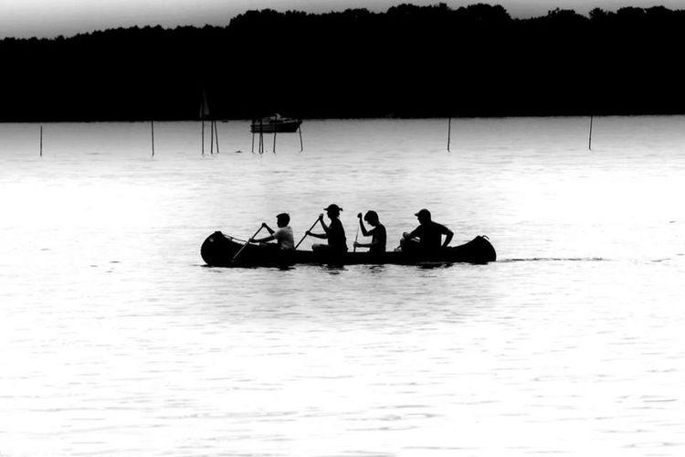 People boating on lake