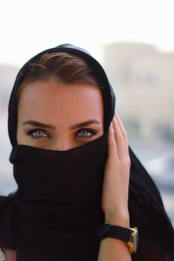 Portrait Of Woman Covering Face With Headscarf