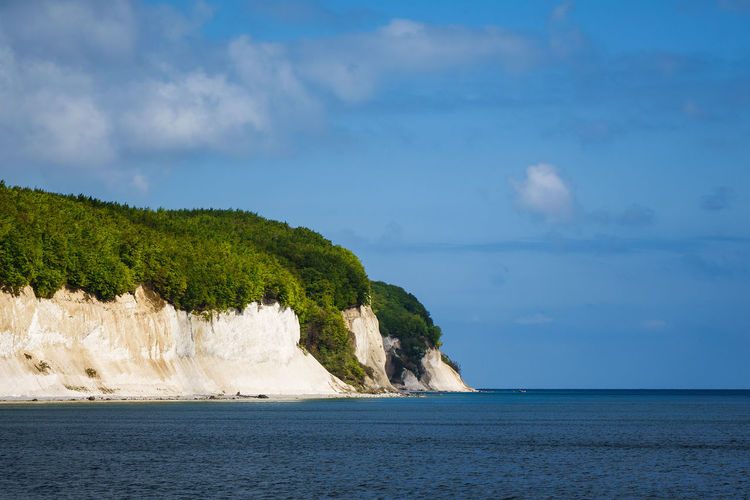 Chalk cliffs on the island Ruegen, Germany. Baltic Sea Chalk Cliffs Relaxing Rügen Trees Beauty In Nature Cloud - Sky Coast Day Forest Journey Nature No People Outdoors Ruegen Scenics Sea Shore Sky Tourism Travel Destinations Vacation Water White Cliffs