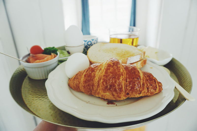 Serving breakfast Baguette Bowl Bread Breakfast Breakfast Time Breakfast ♥ Close-up Croissant Day Egg Food Food And Drink French Food Freshness Healthy Eating Hummus Indoors  No People Plate Ready-to-eat Serving Dish Serving Size Table Toasted Bread Tray