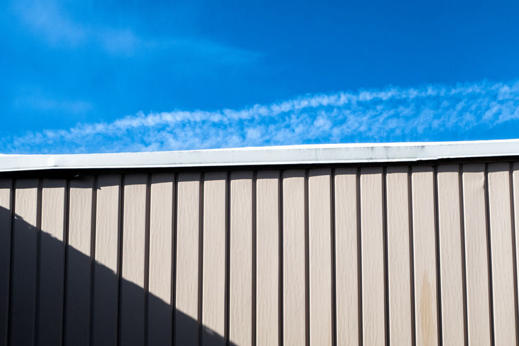 Half wall with shadow half blue sky Architecture Diagonal LINE Lines Modern Shadows & Lights Shapes Wall Architecture Blue Building Exterior Close-up Cloud - Sky Corrugated Iron Day No People Old Outdoors Pattern Shadow Sky Wallpaper Colour Your Horizn