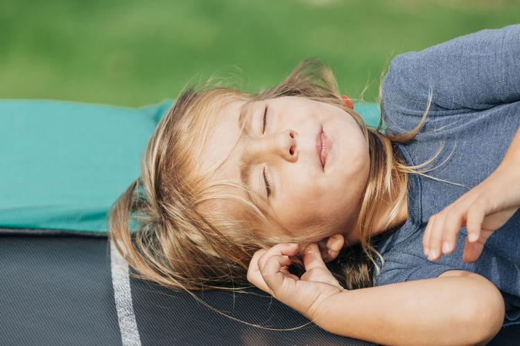 Girl lying on bench