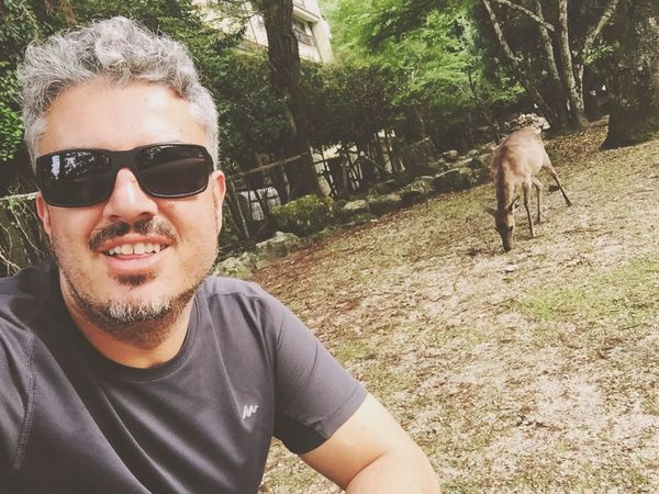 Sunglasses Portrait Looking At Camera Domestic Animals Mammal Outdoors Real People Animal Themes Day One Person Smiling Nature Young Adult Adult People