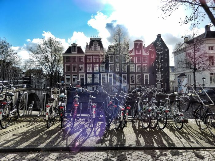 Neighborhood Map Architecture Sunlight Streetphotography Cityscapes Bicycles Clouds Light And Shadows Outdoors Bicycles Of Amsterdam City Life Dutch Houses My Favourite Place Street Photography Urban Photography in Amsterdam, Netherlands