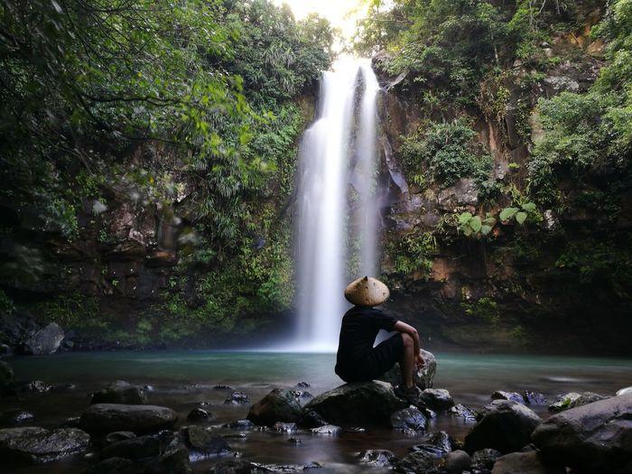 Tourist at waterfall