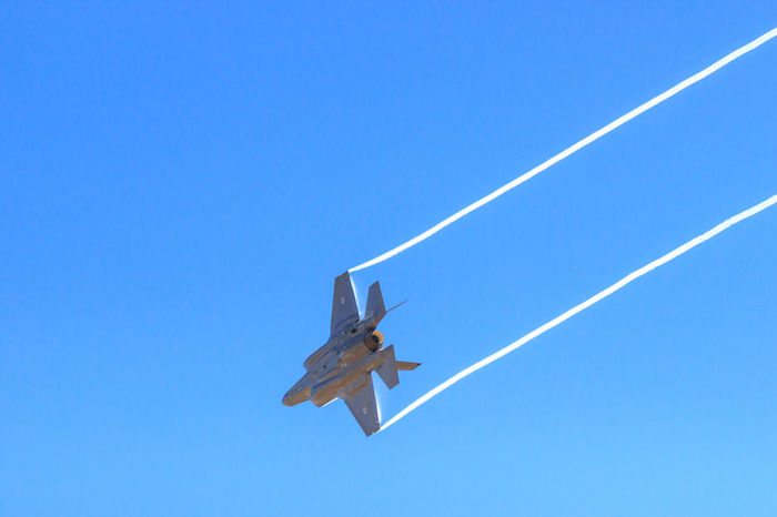Lockheed Martin F-35 Lightning II - Australian version Air Vehicle Airplane Blue Clear Sky Contrail Day F-35 Lightning II Fighter Plane Fighter Planes Flying Jet Fighter Low Angle View Military Nature No People Outdoors Plane Vapor Trail