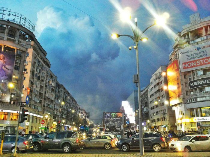 Illuminated city against sky