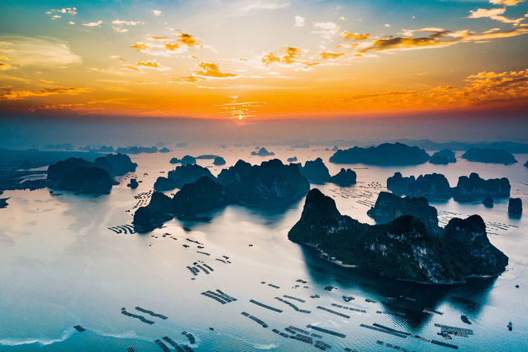 Aerial view of sea against sky during sunset
