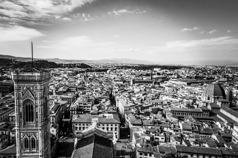 Giotto's Campanile and Florence, the city of lilies. Giotto's Bell Tower Giotto's Campanile Giotto Florence Campanile Bell Tower Firenze Rooftops Tuscany Italy Renaissance Landmark City Skyline Black And White Monochrome Black And White Photography Monochrome Photography Clouds Sky Travel Europe Historic Streets Landmark