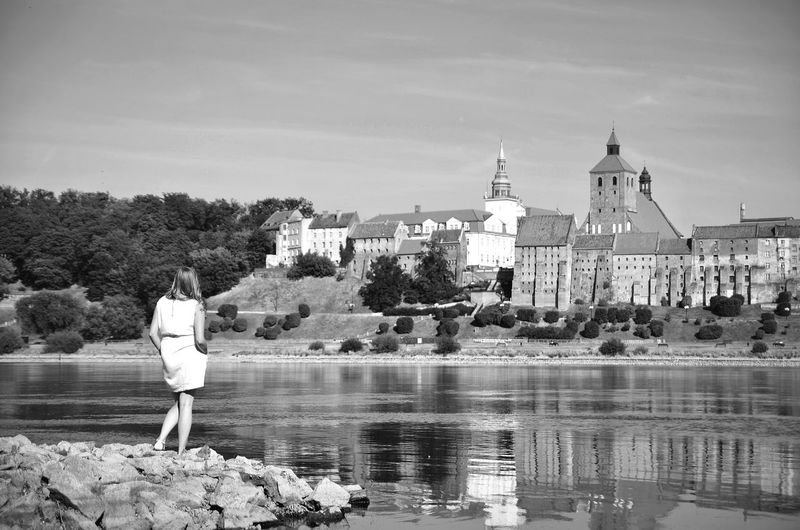 Rear View One Person Water Sky One Woman Only Women Outdoors People Architecture One Young Woman Only Day City Nature Young Adult Only Women Grudziądz Wisla Vistula River Poland Girl Travel Trip Adventure The Great Outdoors - 2017 EyeEm Awards