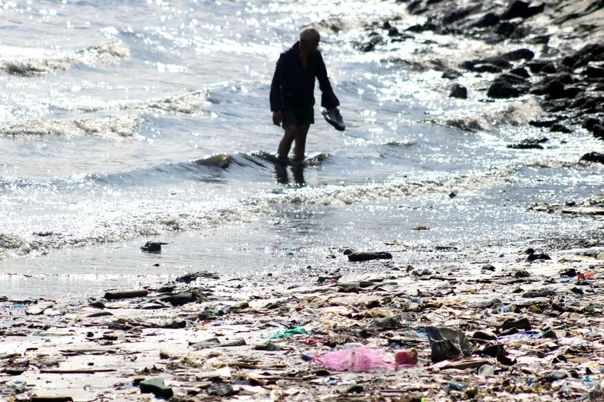 Old man and the sea. Polluted Sea