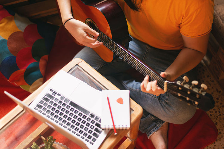 High angle view of man playing guitar
