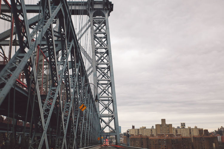 Low angle view of williamsburg bridge against sky