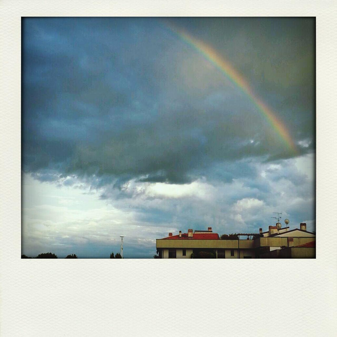 Rainbow Sky With Building