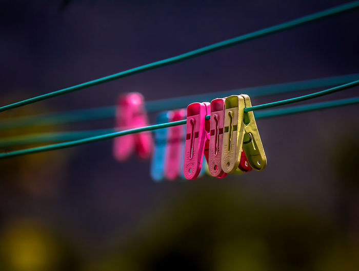 Cable Clip Clips On Wire Close-up Clothesline Clothespin Focus On Foreground Group Of Objects Hanging Multi Colored No People Plastic Red Selective Focus Still Life
