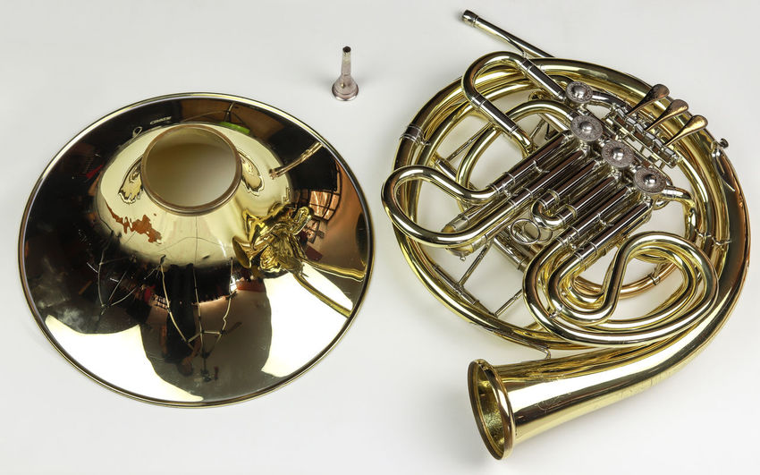 Music Instrument French horn Metal Music Musical Instrument Indoors  White Background Arts Culture And Entertainment Gold Colored Still Life Brass Instrument  No People Close-up Studio Shot High Angle View Cut Out Musical Equipment Brass Table Directly Above Wind Instrument Reflection Silver Colored