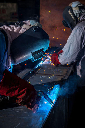 Welders Working In Industry