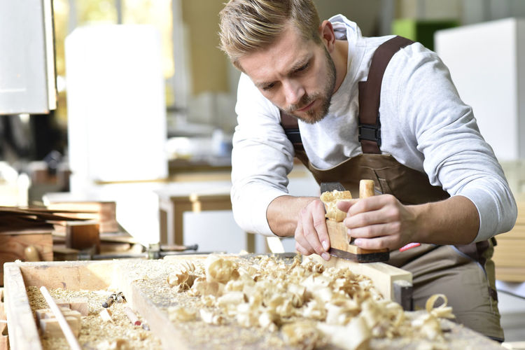 Midsection of man preparing food at table