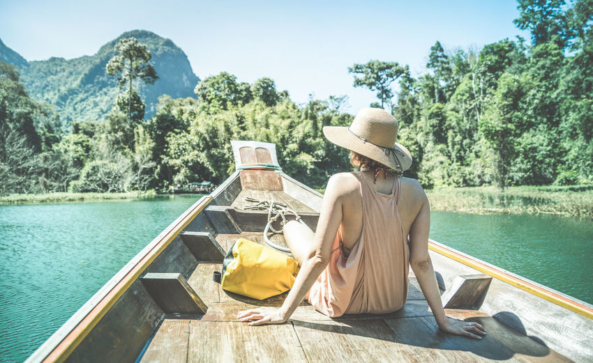 Solo woman traveler at longtail boat tour in Khao Sok lake near Phuket Thailand Alone Excursion Khao Sok National Park Life Longtail Nature Travel Travel Photography Traveling Trip Vietnam Wanderlust Woman Beach Female Hipster Inspiration Khao Sok Lake Longtail Boat Longtailboat Luxury Ratchaprapadam Travel Destinations Young Woman
