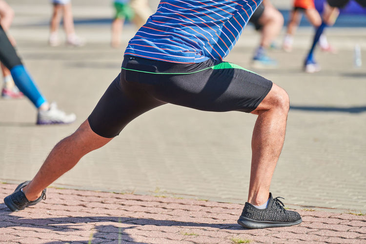 Low section of man running