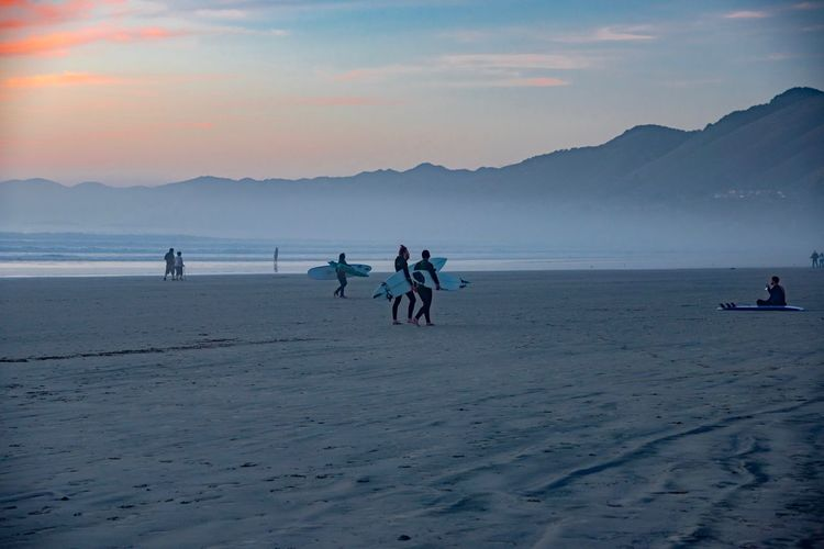 Sky Real People Sea Group Of People Water Beach Land Sunset Beauty In Nature Scenics - Nature Men Lifestyles Leisure Activity Nature Mountain Holiday People Vacations Trip Outdoors Horizon Over Water