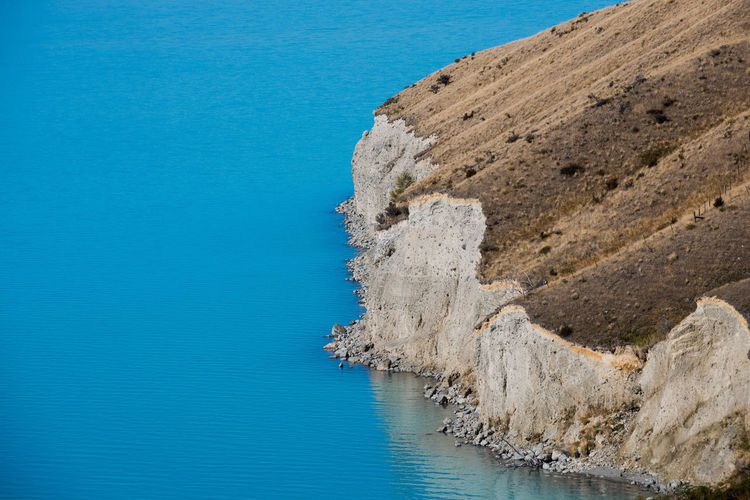 High angle view of cliff in lake pukaki