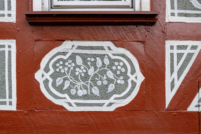 Architecture Built Structure Art And Craft Day Building Exterior Wall - Building Feature Representation No People Text Human Representation Communication Wall Creativity Close-up Craft Outdoors Building Brick Pattern Western Script Mural