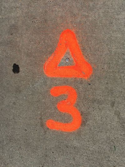 Spraypaint Street Surface Neon Color Orang Number Three Triangle Street Paint