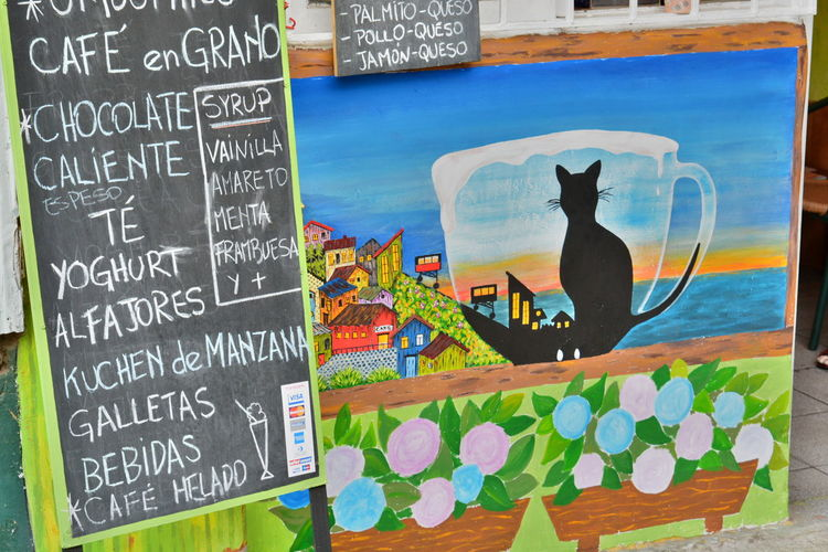 Mural artwork. Valparaiso. Chile ArtWork Cafe Menu Cat Chile Chilean  City City Life Cityscape Colorful Menu Mural Mural Art Outdoors Painting Southamerica Text Tourism Traditional Travel Travel Destinations Valparaiso, Chile Valparaíso